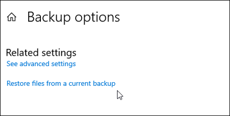"""Screenshot of Microsoft """"Backup options"""" window, with Related Settings that says """"See advanced settings"""" and """"Restore files from a current backup""""."""