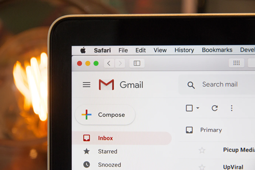 Macbook with Gmail Inbox Open Where Phishing Emails Have Increased Due to Coronavirus
