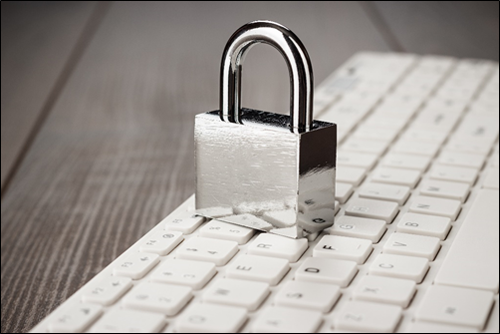 Padlock sitting on keyword, signaling organizations have to fight against cybersecurity threats to Canadian organizations.