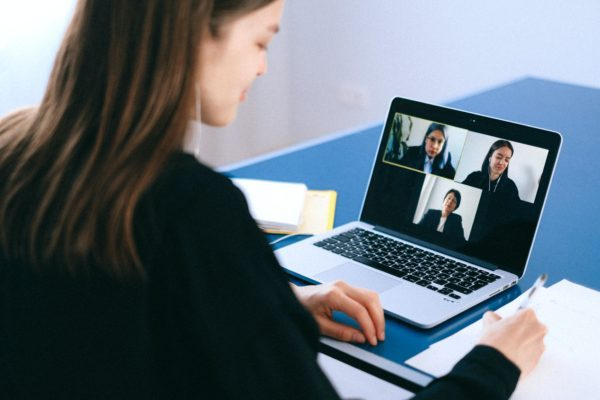 Woman on video conference on laptop